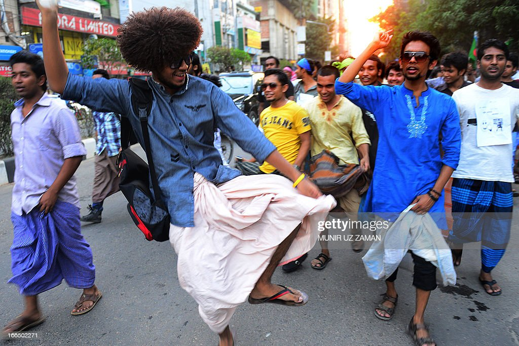 Facebook activists march to protest a ban on rickshaw pullers wearing 'lungi' - traditional men's clothing - from entering Baridhara, one of the most exclusive suburbs of Dhaka on April 13, 2013. Baridhara Society, the home owner's association, has instructed security personnel not to let in rickshaw-pullers in lungi but requiring them to wear trousers, according to security men and local commuters. AFP PHOTO/Munir uz ZAMAN