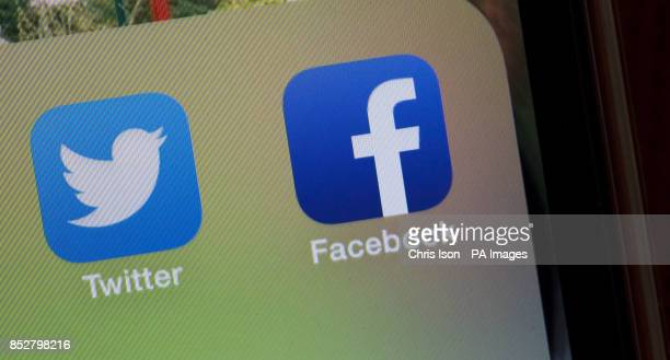 Facebook and Twitter icons as seen on an iPhone5 mobile phone PRESS ASSOCIATION Photo Picture date Tuesday December 10 2013 Photo credit should read...