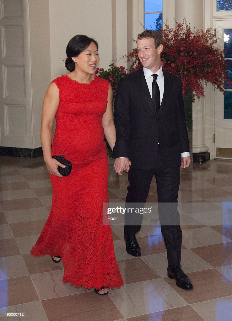 Facebook CEO <a gi-track='captionPersonalityLinkClicked' href=/galleries/search?phrase=Mark+Zuckerberg&family=editorial&specificpeople=4841191 ng-click='$event.stopPropagation()'>Mark Zuckerberg</a> and Dr. <a gi-track='captionPersonalityLinkClicked' href=/galleries/search?phrase=Priscilla+Chan&family=editorial&specificpeople=4125446 ng-click='$event.stopPropagation()'>Priscilla Chan</a> arrive for a state dinner in honor of Chinese President President Xi Jinping and his wife Peng Liyuan at the White House September 25, 2015in Washington, DC. Xi arrived in Washington, the second stop of his state visit to the United States, on Thursday after a busy two-and-a-half-day stay in Seattle.