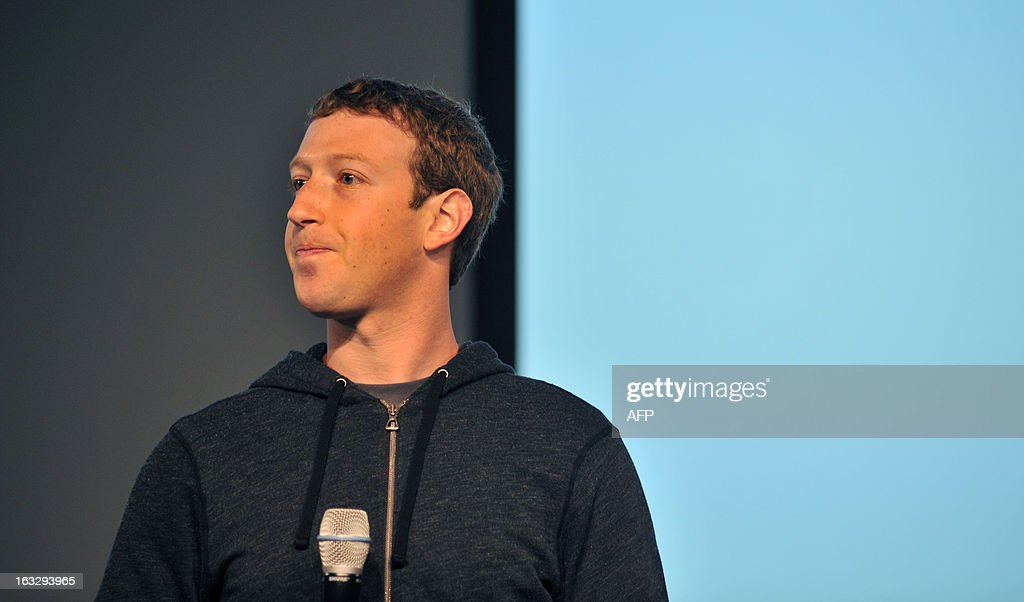 Facebook CEO Mark Zuckerberg answers questions during a media event at Facebook's headquarters in Menlo Park, California on March 7, 2013. Facebook on Thursday began transforming the stream of updates from friends at home pages into a 'personalized newspaper' with news ranging from the personal to the global. The News Feed on home pages at the leading social network was revamped to get rid of clutter and present 'bright, beautiful' stories whether they are insights from friends or trending news of the day. AFP PHOTO /Josh EDELSON
