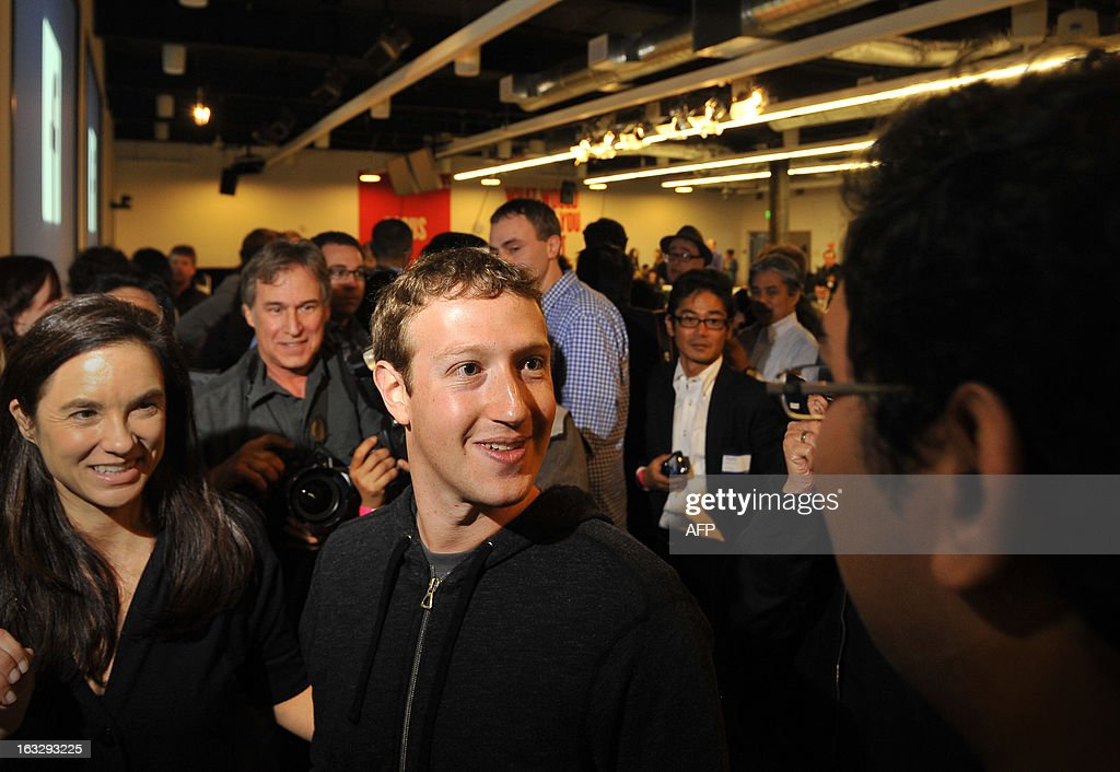 Facebook CEO Mark Zuckerberg is seen during a media event at Facebook's headquarters in Menlo Park, California on March 7, 2013. Facebook on Thursday began transforming the stream of updates from friends at home pages into a 'personalized newspaper' with news ranging from the personal to the global. The News Feed on home pages at the leading social network was revamped to get rid of clutter and present 'bright, beautiful' stories whether they are insights from friends or trending news of the day. AFP PHOTO /Josh EDELSON