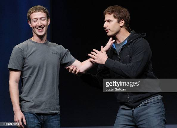 Facebook CEO Mark Zuckerberg jokes with comedian Andy Samberg during a keynote address during the Facebook f8 conference on September 22 2011 in San...