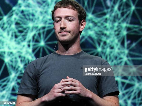 Facebook CEO Mark Zuckerberg pauses as he delivers a keynote address during the Facebook f8 conference on September 22 2011 in San Francisco...