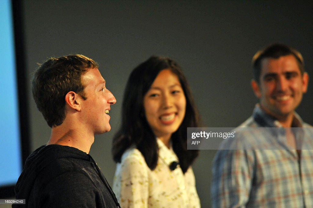 Facebook CEO Mark Zuckerberg speaks alongside The VP of Product Chris Cox, and Director of Design For Newsfeed Julie Zhuo during a media event at Facebook's Headquarters office in Menlo Park, California on March 07, 2013. Facebook on Thursday began transforming the stream of updates from friends at home pages into a 'personalized newspaper' with news ranging from the personal to the global. The News Feed on home pages at the leading social network was revamped to get rid of clutter and present 'bright, beautiful' stories whether they are insights from friends or trending news of the day. AFP PHOTO /Josh EDELSON