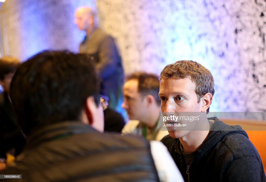 Facebook CEO <a gi-track='captionPersonalityLinkClicked' href=/galleries/search?phrase=Mark+Zuckerberg&family=editorial&specificpeople=4841191 ng-click='$event.stopPropagation()'>Mark Zuckerberg</a> (R) speaks with a reporter during an event at Facebook headquarters during an event at Facebook headquarters on April 4, 2013 in Menlo Park, California. Zuckerberg announced a new product for Android called Facebook Home as well as the new HTC First phone that will feature the new software.
