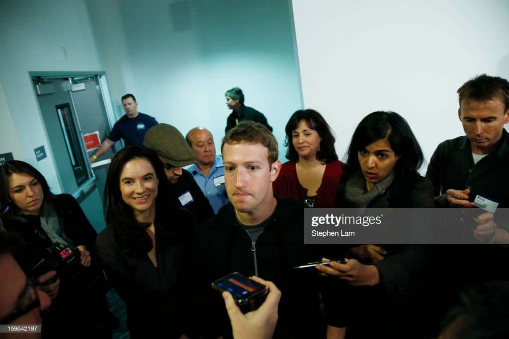 Facebook Chairman and Chief Executive <a gi-track='captionPersonalityLinkClicked' href=/galleries/search?phrase=Mark+Zuckerberg&family=editorial&specificpeople=4841191 ng-click='$event.stopPropagation()'>Mark Zuckerberg</a> is surrounded by members of the media after announcing Graph Search feature January 15, 2013 in Menlo Park. Facebook announced a search function that works within the website and allows users to search content that people have shared with you or is public.