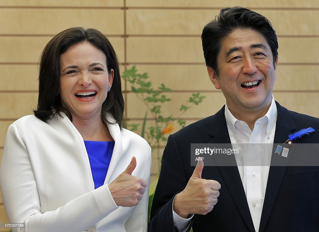 Facebook Chief Operating Officer Sheryl Sandberg (L) and Japanese Prime Minister Shinzo Abe (R) pose for photographers prior to their meeting at the start of their meeting at his official residence in Tokyo on July 2, 2013. The first national election that will allow e-campaigning in Japan, including permitting candidates to use Facebook on the campaign trail to attract supporters, will be upper-house polls which are set for July 21. AFP PHOTO / ITSUO INOUYE / POOL