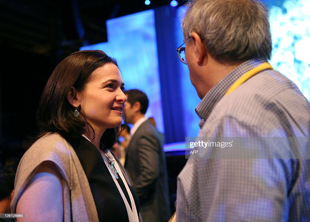 Facebook Chief Operating Officer Sheryl Sandberg talks to an attendee during the Facebook f8 Developer Conference at the San Francisco Design Center September 22, 2011 in San Francisco, California. AFP PHOTO/Kimihiro Hoshino