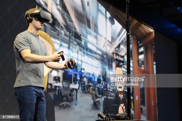 Facebook cofounder and chief executive Mark Zuckerberg speaks at an Oculus developers conference while wearing a virtual reality headset in San Jose...