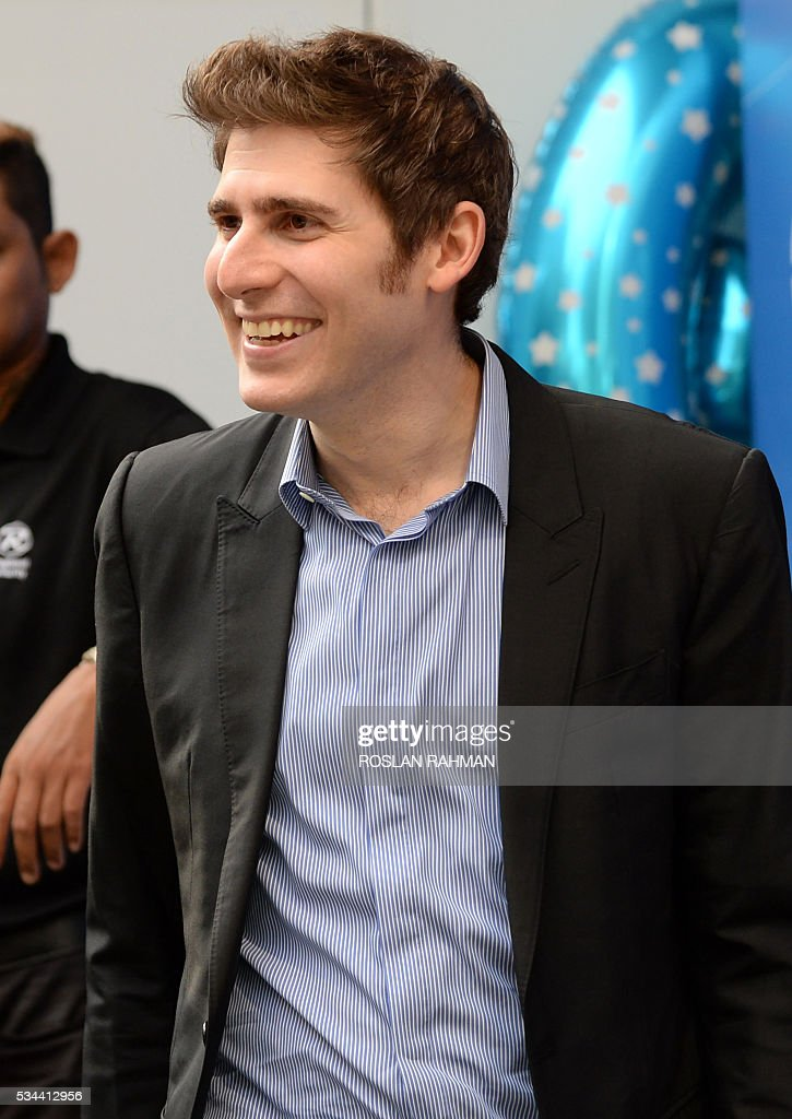 Facebook co-founder Eduardo Saverin attends the 99.co second Anniversary and 99PRO Launch in Singapore on May 26, 2016. / AFP / ROSLAN