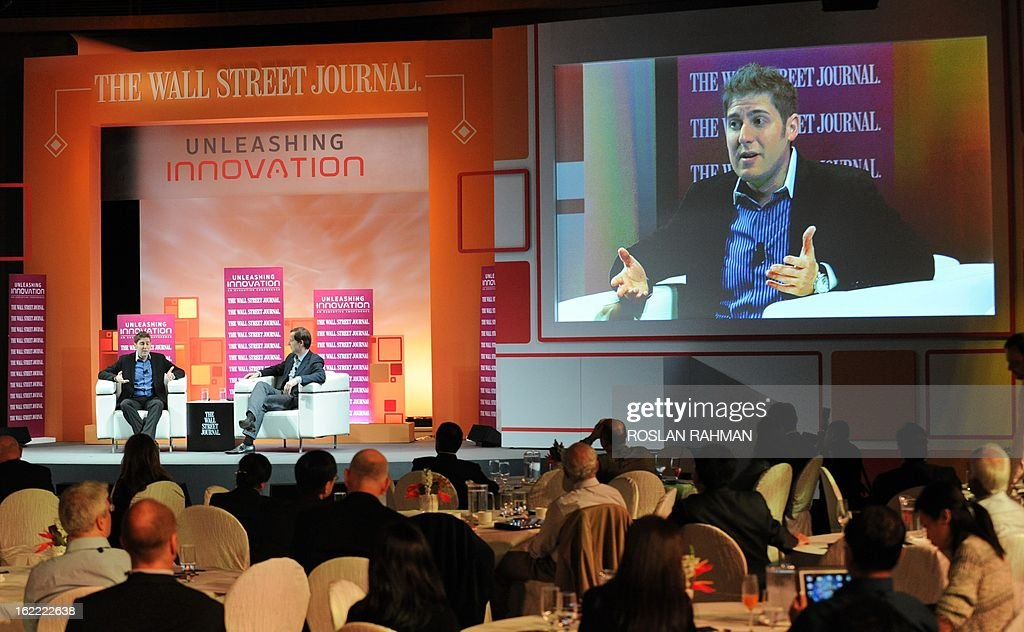 Facebook co-founder Eduardo Saverin (seated L) speaks during the Wall Street Journal Unleashing Innovation executive conference held at Capella Singapore, Sentosa Island in Singapore on February 21, 2013. The Singapore-based billionaire said Facebook would be a 'tough act' to follow but he wants to have a 'positive impact' on the world as an investor. AFP PHOTO / ROSLAN RAHMAN