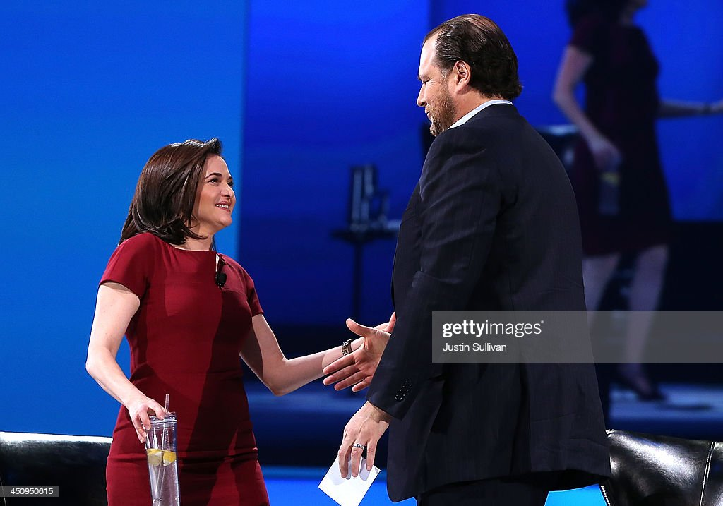 Facebook COO <a gi-track='captionPersonalityLinkClicked' href=/galleries/search?phrase=Sheryl+Sandberg&family=editorial&specificpeople=5922850 ng-click='$event.stopPropagation()'>Sheryl Sandberg</a> (L) greets Salesforce chairman and CEO <a gi-track='captionPersonalityLinkClicked' href=/galleries/search?phrase=Marc+Benioff&family=editorial&specificpeople=6871116 ng-click='$event.stopPropagation()'>Marc Benioff</a> (R) at the 2013 Dreamforce conference on November 20, 2013 in San Francisco, California. The annual Dreamforce conference runs through November 21.