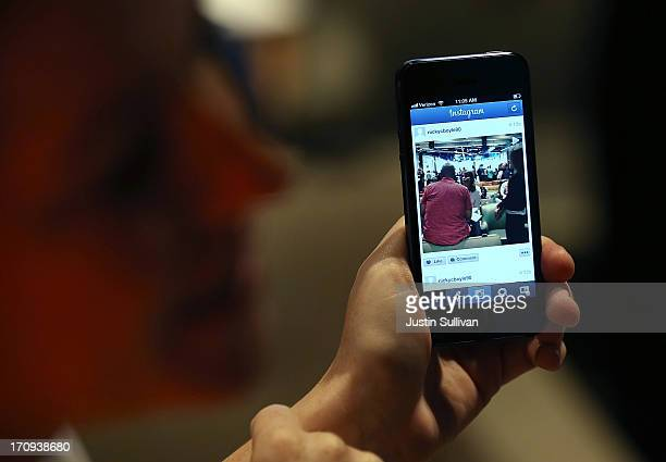 Facebook employee demonstrates the new Instagram video option during a press event at Facebook headquarters on June 20 2013 in Menlo Park California...