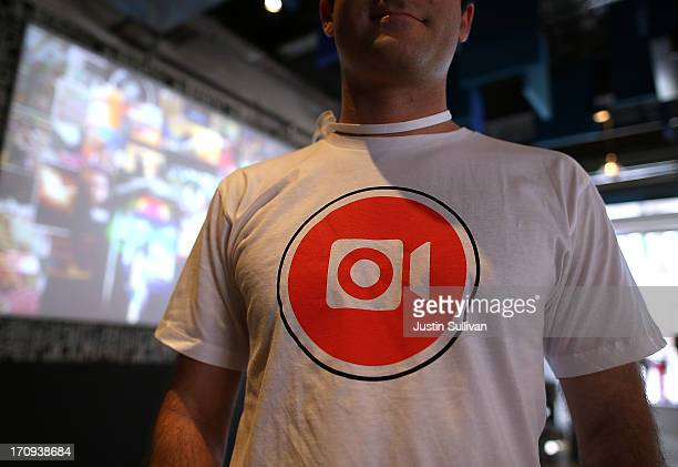 Facebook employee wears a shirt with the logo of the new Instagram video option during a press event at Facebook headquarters on June 20 2013 in...