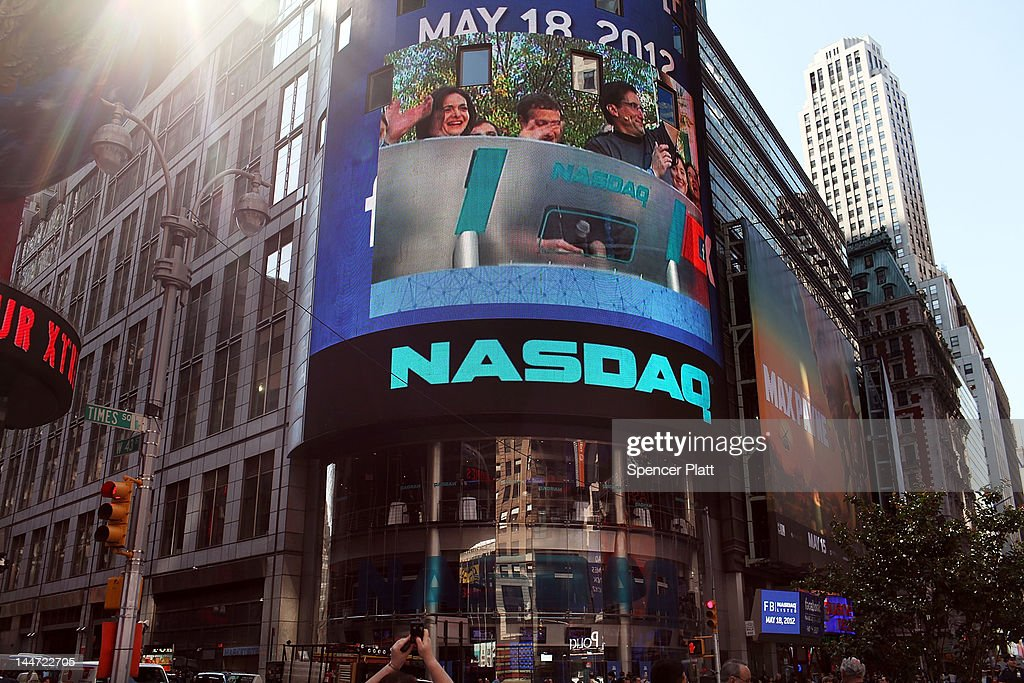 Facebook employees at Menlo Park are seen on the Nasdaq board seconds before founder Mark Zuckerberg rings the Opening Bell for the Nasdaq stock market board on May 18, 2012 in New York, United States. The social network site is set to begin trading at roughly 11:00 a.m. ET and on Thursday priced 421 million shares at $38 each. Facebook, a Menlo Park, California based company, will have a valuation exceeding $100 billion.