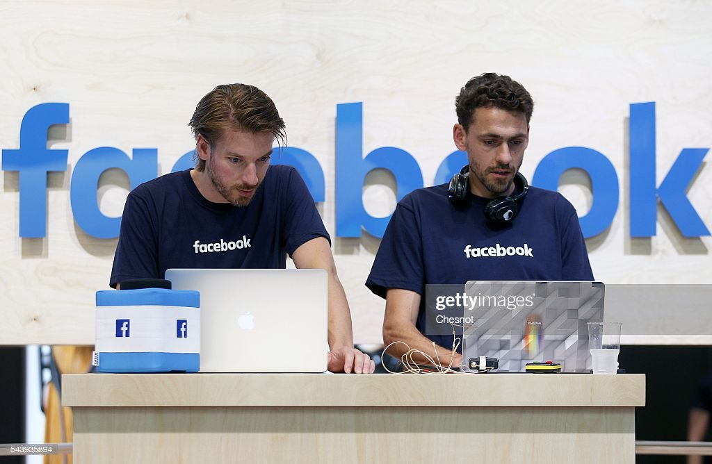 Facebook employees check their computers during the Viva Technology show on June 30, 2016 in Paris, France. Viva Technology Startup Connect, the new international event brings together 5,000 startups with top investors, companies to grow businesses and all players in the digital transformation who shape the future of the internet.