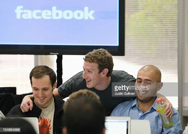 Facebook founder and CEO Mark Zuckerberg greets Facebook employees before speaking at a news conference at Facebook headquarterson October 6 2010 in...