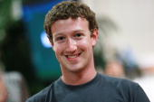 Facebook founder and CEO Mark Zuckerberg smiles before speaking at a news conference at Facebook headquarters August 18 2010 in Palo Alto California...