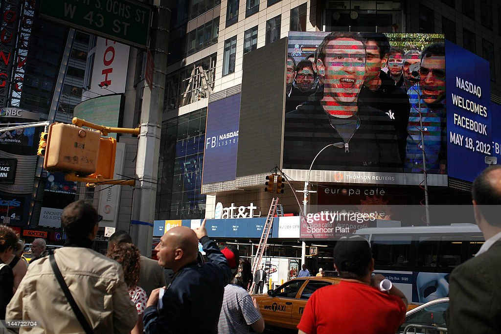Facebook founder Mark Zuckerberg is seen on a screen in Times Square moments after he rang the Opening Bell for the Nasdaq stock market board on May 18, 2012 in New York, United States. The social network site is set to begin trading at roughly 11:00 a.m. ET and on Thursday priced 421 million shares at $38 each. Facebook, a Menlo Park, California based company, will have a valuation exceeding $100 billion.