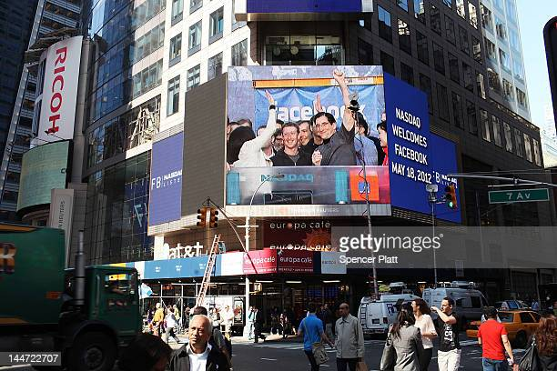 Facebook founder Mark Zuckerberg is seen on a screen in Times Square moments after he rang the Opening Bell for the Nasdaq stock market board from...