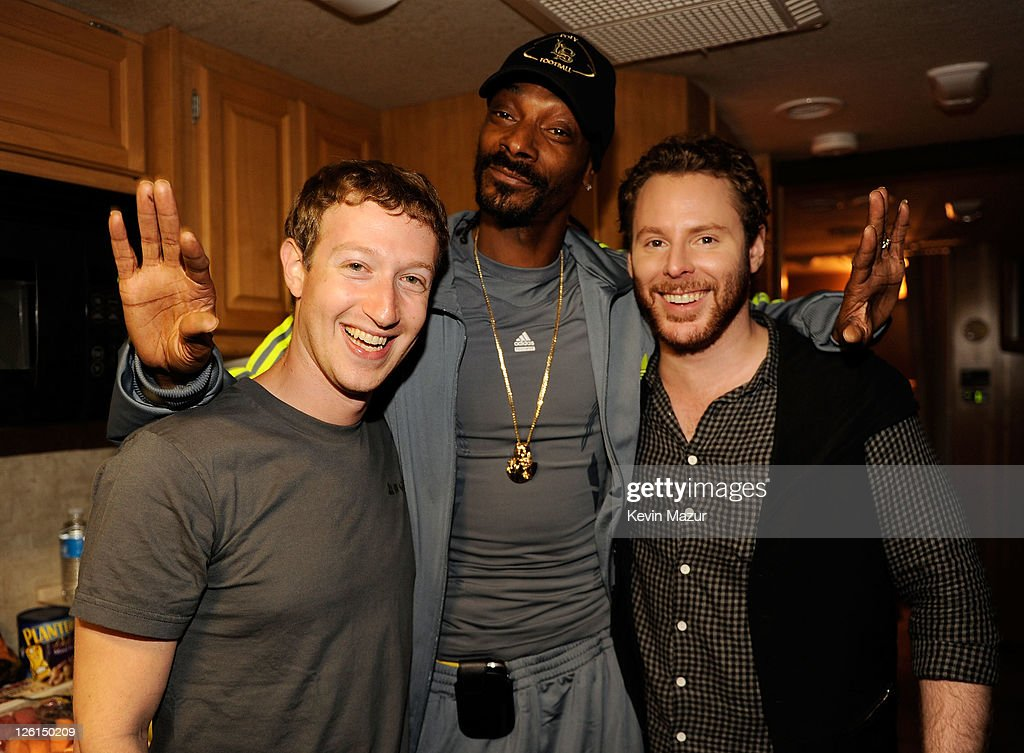Facebook founder Mark Zuckerberg rapper Snoop Dogg and entrepreneur Sean Parker pose backstage at Sean Parker's Celebration of Music on September 22...