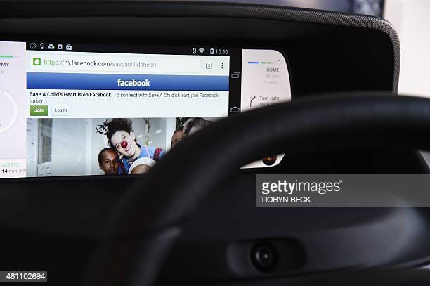 Facebook from a wirelessly connected smartphone is seen on the mockup display of Valeo's Mobi/us autonomous dashboard a concept for interacting with...