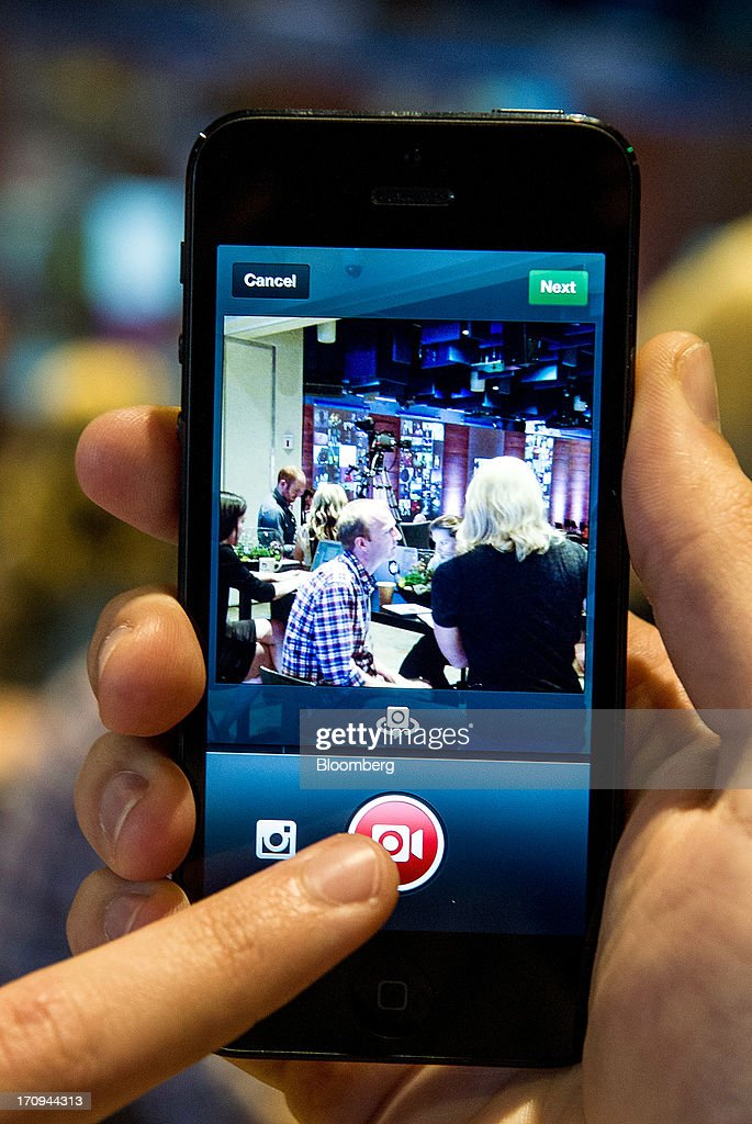 A Facebook Inc. employee demonstrates the new video feature with Instagram during an event at the company's headquarters in Menlo Park, California, U.S., on Thursday, June 20, 2013. Facebook Inc., operator of the largest social network, plans to unveil video-sharing tools, bringing its Instagram into closer competition with Twitter Inc., a person with knowledge of the matter said. Photographer: David Paul Morris/Bloomberg via Getty Images