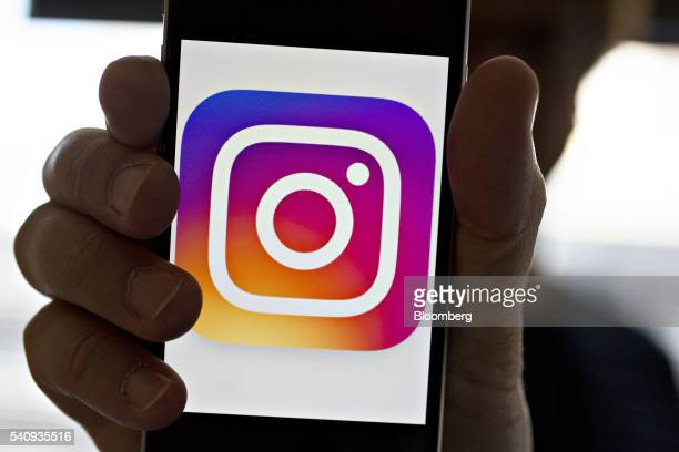Facebook Inc's Instagram logo is displayed on an Apple Inc iPhone in this arranged photograph taken in Washington DC US on Friday June 17 2016 In a...