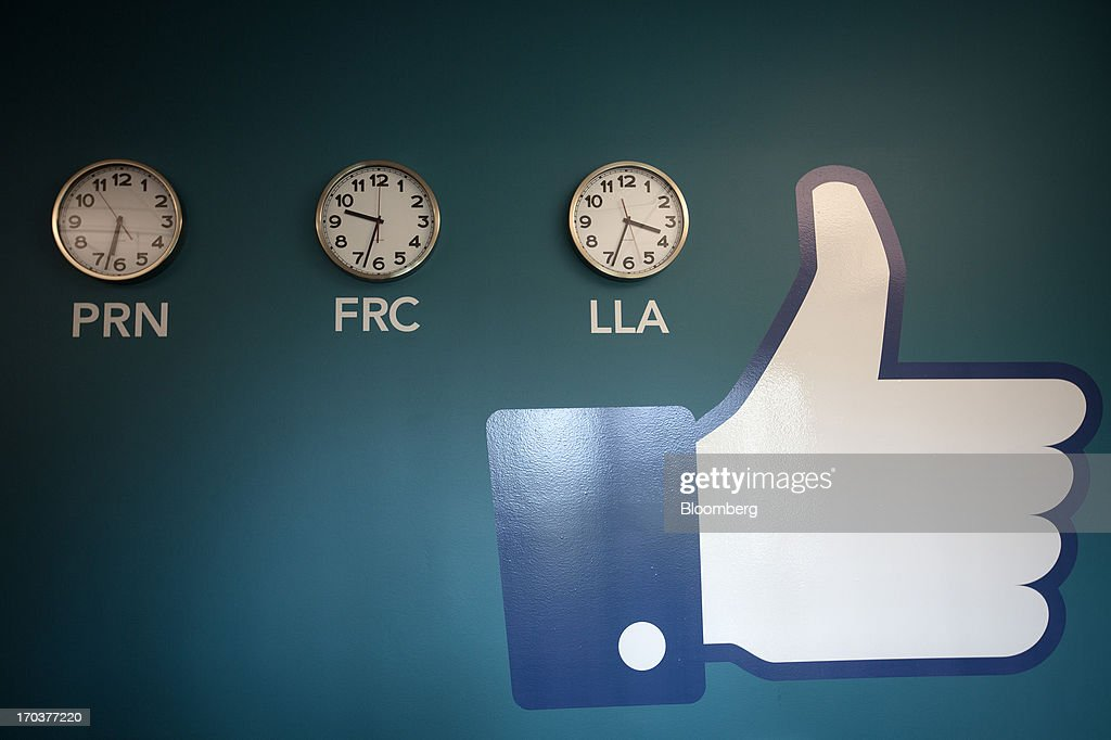 A Facebook 'Like' button sits on a wall display beside clocks inside Facebook Inc.'s new data storage center near the Arctic Circle in Lulea, Sweden, on Wednesday, June 12, 2013. The data center is Facebook's first outside the U.S., poised to handle all data processing from Europe, Middle East and Africa and the server hub is largest of its kind in Europe, and most northerly of its magnitude anywhere on earth. Photographer: Simon Dawson/Bloomberg via Getty Images