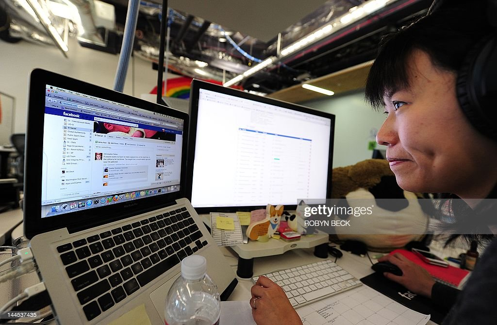 Facebook User Operations team member Kristie Chow checks a page of the number one social networking website at the Facebook headquarters in Menlo Park, California, May 15, 2012. The User Operations team provides support for Facebook users around the work. Facebook, the world's most popular internet social network, expects to raise USD 12.1 billion in what will be Silicon Valley's largest-ever initial public offering (IPO) later this week.