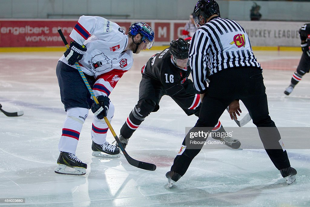 Face-off during the group stage match between Fribourg-Gotteron and Eisbaeren Berlin on August 23, 2014 in Fribourg, Switzerland.