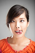 Faces Series: Young woman making a looney facial grimace.