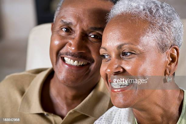 Faces of happy senior African American couple, focus on woman