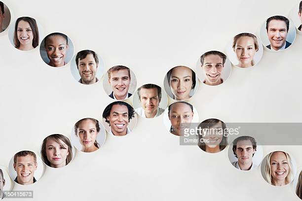 Faces on discs in X formation, a man in the center