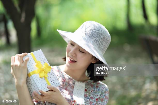 Facial expression of a woman who is glad to see the present box