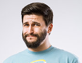 Portrait of bearded guy with disgusted expression on face
