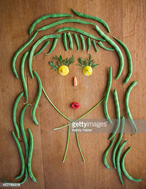 Facial illustrations made from vegetables and frui