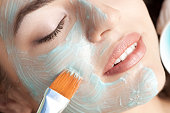 Healthy spa: young beautiful relaxing woman having moistening mask applied. PLEASE, CLICK FOR SIMILAR IMAGES AND LIGHTBOXES .