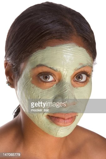 Facial mask on black girl : Stock Photo