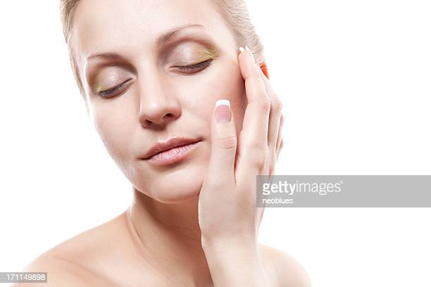 Gesichtsmassage mit Creme