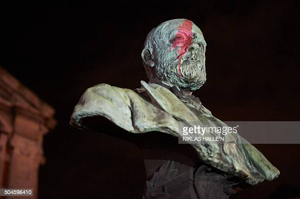 A facial painting can be seen on the statue of Sir Henry Tate as crowds gather outside the Ritzy cinema in south London to pay homage to British...