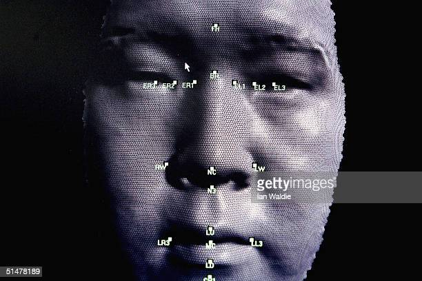 A 3D facial recognition program is demonstrated during the Biometrics 2004 exhibition and conference October 14 2004 in London The conference will...