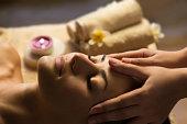 Beautiful woman getting spa treatment. Facial massage