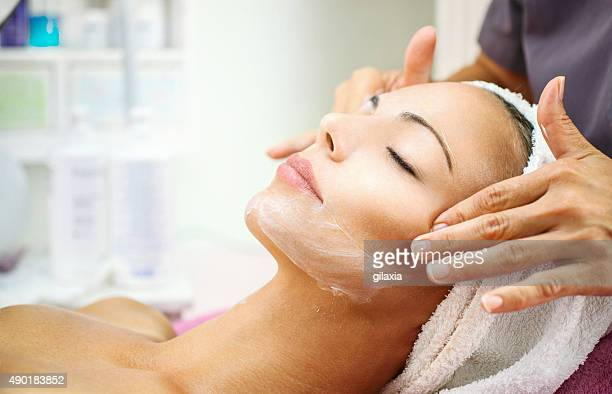 Facial treatment at beauty salon.