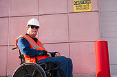 Facilities engineer in wheelchair at hard hat area