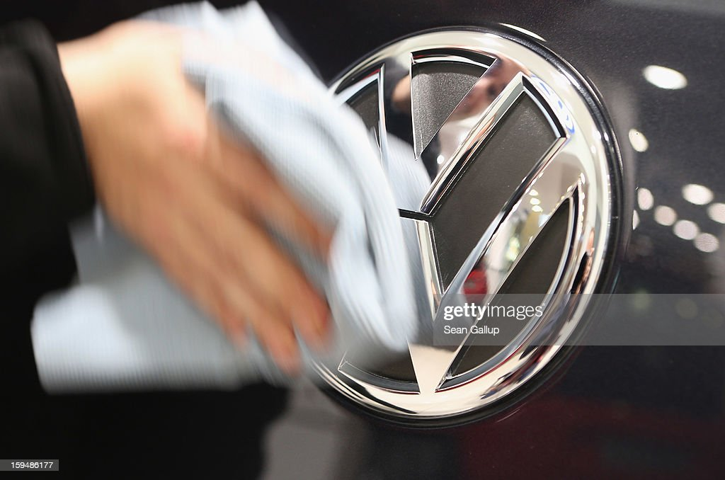 A facilities worker wipes clean the VW logo on a car at a Volkswagen Group showroom on January 14, 2013 in Berlin, Germany. Volkswagen Group, which includes the VW, Audi, Porsche, Skoda, SEAT, Bentley and Bugatti brands, delivered a record 9.07 million cars to customers in 2012. Rising sales in the Americas and Asia helped to offset a drop in sales in western Europe.