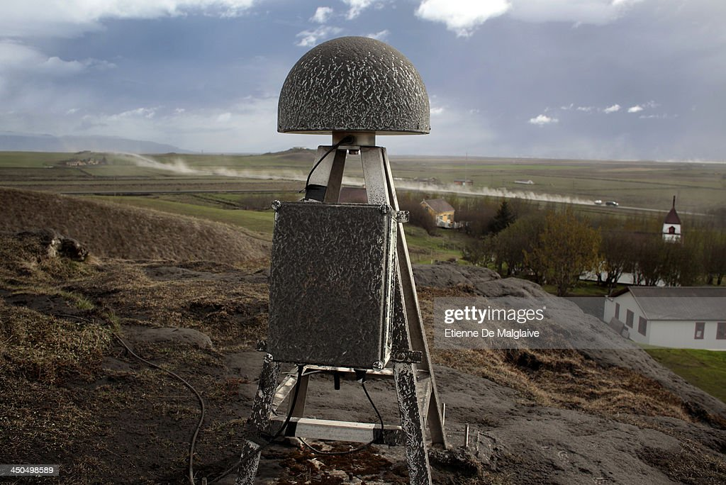 Facing the volcano hidden by low clouds, a GPS Deformation sensor is posted on a hill top in Hvolsvollur, a small town east of the volcano, monitoring ground movements of Iceland's Eyjafjallajokull that has send an ash cloud toward continental Europe, forcing a lock down of major airports on May 14, 2013 in Reykjavik, Iceland.