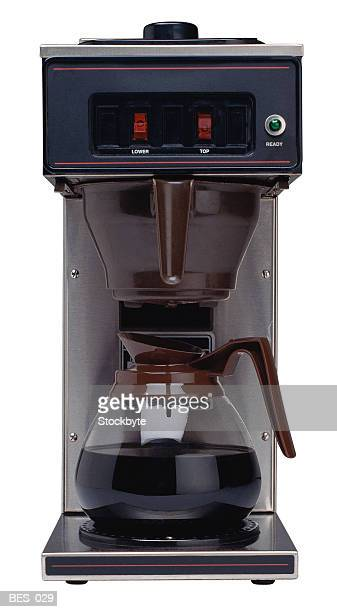 Facing view of pot of coffee brewing on automatic drip machine