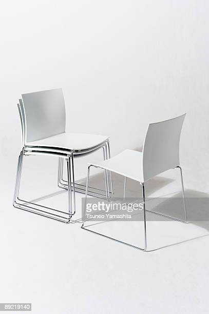 facing white chairs