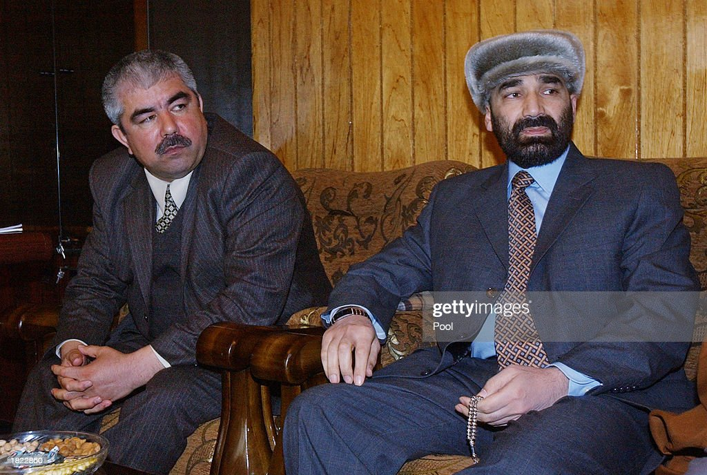 Factional leaders from northern Afghanistan, General Abdul Rashid Dostum (L) and Atta Mohammed sit next to each other during a meeting at the Ministry of Foreign Affairs February 28, 2003 in Mazar-e-Sharif, Afghanistan. The group, which included numerous other factional leaders and the United Nations High Commisioner for Refugees Ruud Lubbers, unanimously agreed to improve the infrastructure of the region so displaced people can return home.